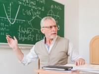 old-teacher-explaining-lecture-room_23-2148201048